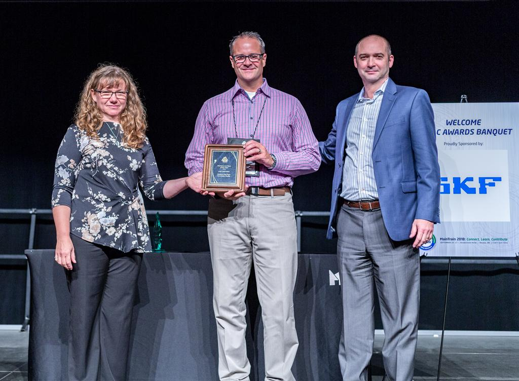 Receiving the award on behalf of the team, Greg Wright and J.-P. Pascoli.